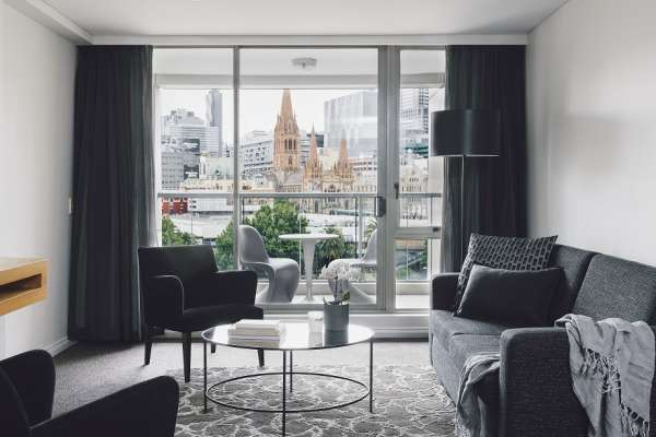 QuayWestMelbourne-2 Bedroom Deluxe Suite - City & River View Living Room.jpg